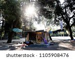 Small photo of Refugees and migrants rest in at a makeshift camp at Pedion tou Areos park where some 1500 migrants and refugees live in a makeshift camps in Athens, Greece on Aug. 3, 2015