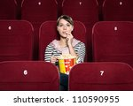 young girl at the cinema... | Shutterstock . vector #110590955