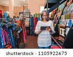 mature fabric shop owner using... | Shutterstock . vector #1105922675