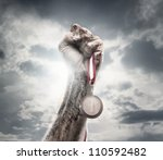 male hand holding gold medal... | Shutterstock . vector #110592482