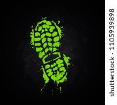 a trace from a boot on a black... | Shutterstock .eps vector #1105939898