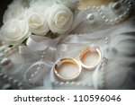 two wedding rings with white... | Shutterstock . vector #110596046