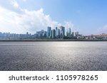 city skyline with empty road in ... | Shutterstock . vector #1105978265