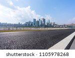 city skyline with empty road in ... | Shutterstock . vector #1105978268