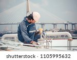 male worker are ultrasonic... | Shutterstock . vector #1105995632
