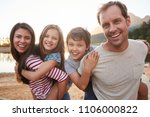 portrait of parents giving... | Shutterstock . vector #1106000822