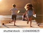 children run towards parents on ...   Shutterstock . vector #1106000825