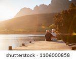 romantic senior couple sitting... | Shutterstock . vector #1106000858