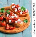 bruschetta with tomato and... | Shutterstock . vector #1106001086