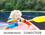child with paddle on kayak.... | Shutterstock . vector #1106017028