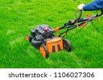 lawn mower on a green field | Shutterstock . vector #1106027306