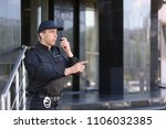 male security guard using... | Shutterstock . vector #1106032385