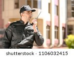 male security guard using... | Shutterstock . vector #1106032415
