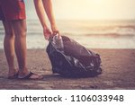 woman are collecting garbage on ... | Shutterstock . vector #1106033948