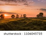 sunrise in a cereal field | Shutterstock . vector #1106045735