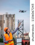 young asian engineer flying... | Shutterstock . vector #1106067245