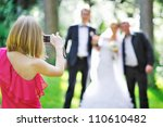 Girl Photographing Guests At...