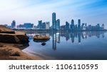 city skyline under sunset sky ... | Shutterstock . vector #1106110595