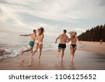 four friends are running on... | Shutterstock . vector #1106125652