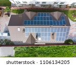 aerial view of house with solar ... | Shutterstock . vector #1106134205