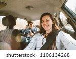 woman driving a car. man... | Shutterstock . vector #1106134268