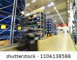 forklift trucks in a warehouse... | Shutterstock . vector #1106138588