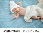 adorable newborn baby in warm... | Shutterstock . vector #1106142452