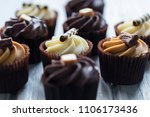 cupcakes decorated with... | Shutterstock . vector #1106173436