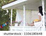 young beautiful girl on a porch | Shutterstock . vector #1106180648