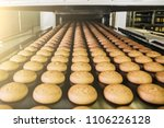 cakes on automatic conveyor... | Shutterstock . vector #1106226128