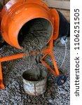 from an orange concrete mixer... | Shutterstock . vector #1106251505