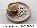 triphala capsules and powder on ... | Shutterstock . vector #1106278865