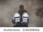 sneakers in the puddle.... | Shutterstock . vector #1106308466