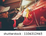 Retro Car Body Cleaning and Paint Restoration. Taking Care of Classic Car. - stock photo