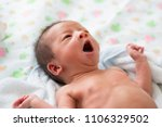 asian baby yawning after bath | Shutterstock . vector #1106329502