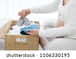 pregnant woman preparing and... | Shutterstock . vector #1106330195