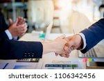 business people shaking hands.... | Shutterstock . vector #1106342456