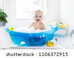 happy laughing baby taking a... | Shutterstock . vector #1106372915