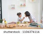 two little girl eating salad... | Shutterstock . vector #1106376116