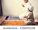 muslim boy learning how to make ... | Shutterstock . vector #1106422148