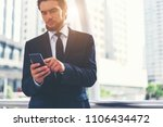 businessman holding smartphone. ... | Shutterstock . vector #1106434472