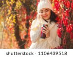 young beautiful woman at autumn ... | Shutterstock . vector #1106439518