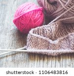knitting needles and yarn on... | Shutterstock . vector #1106483816