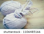 knitting needles and yarn on... | Shutterstock . vector #1106485166