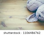 knitting needles and yarn on... | Shutterstock . vector #1106486762