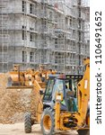 excavator on a construction... | Shutterstock . vector #1106491652