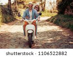 happy young couple riding a... | Shutterstock . vector #1106522882