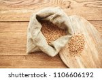 a bag of wheat and a board      ...   Shutterstock . vector #1106606192