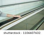 woman holding on handrail when...   Shutterstock . vector #1106607632