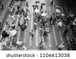 motion blurred pedestrians...   Shutterstock . vector #1106613038